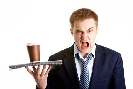 dissatisfied: Portrait of young dissatisfied businessman shouting in isolation Stock Photo