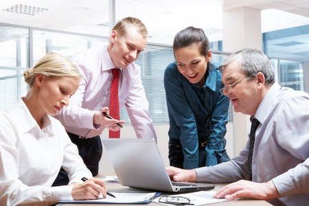 Portrait of busy partners working together in office Stock Photo - 6893472
