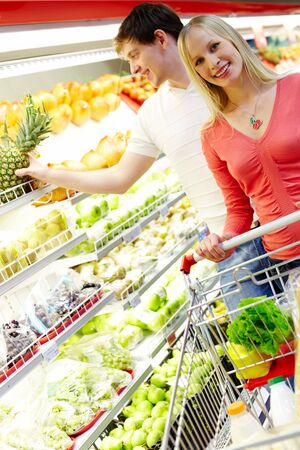 Portrait of happy female looking at camera in supermarket Stock Photo - 6894263