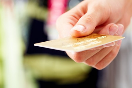 Close-up of credit card in human hand in the shop Stock Photo