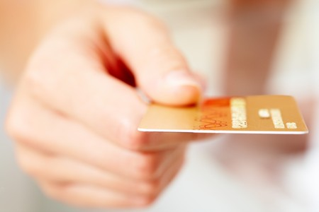 credit card debt: Close-up of human hand holding credit card Stock Photo
