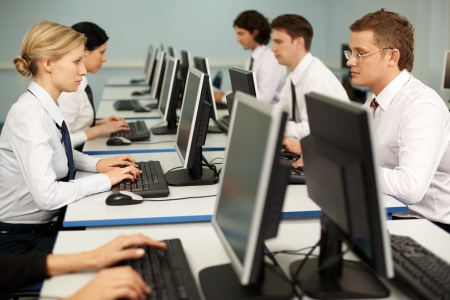 confident businesspeople doing some computer work Stock Photo - 6893460