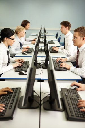 conference call: Image of businesspeople typing on the keyboards in line