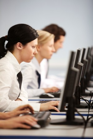 Row of businesspeople concentrating on their computer work  photo
