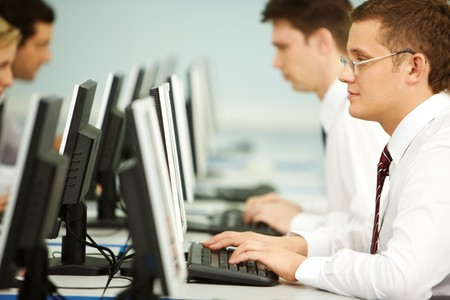 Clever businessmen typing in line at workplace   photo