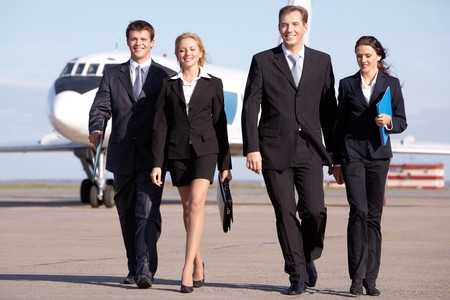 corporate jet: Image of business team walking through the airport Stock Photo