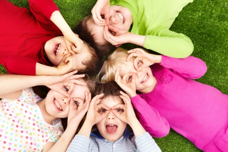 happy children: Image of funny kids playing on the grass
