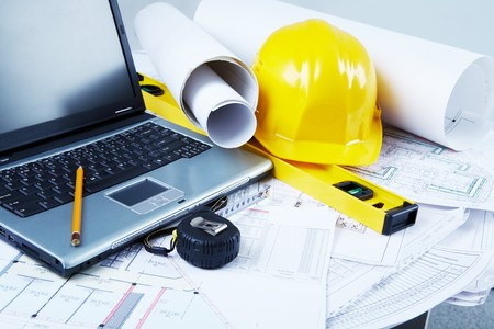 Image of laptop, architectural tools and blueprints photo