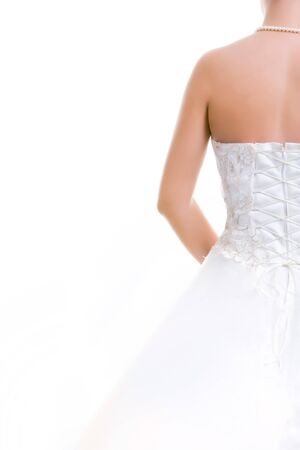 marriageable: Image of back of bride in wedding dress isolated on a white background