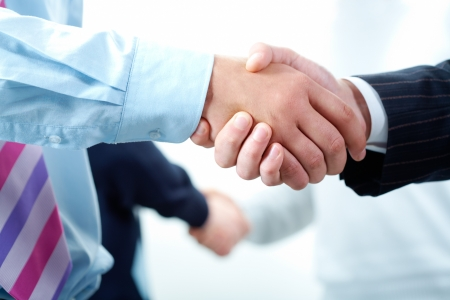 Image of business people's hands making the agreements photo