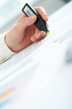 Close-up of female hand holding marker over business document Stock Photo - 6894375