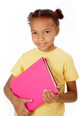 Image of black girl holding book and looking at camera Stock Photo - 6894497