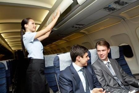 in readiness: businessmen in de airplane