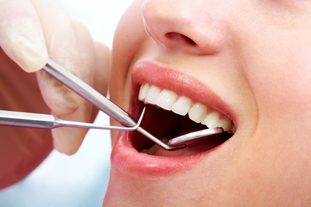 female open mouth during oral inspection with mirror and hook Stock Photo - 6894908