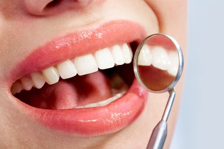 saliva: Image of beautiful mouth with health teeth and mirror Stock Photo