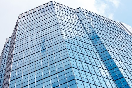 building glass: Image of modern office building against cloudy sky Stock Photo