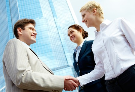 successful associates handshaking after striking deal outdoors at meeting Stock Photo - 6894982