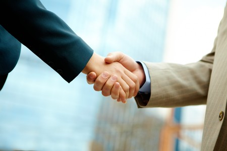 handshake of business partners after striking deal  Stock Photo - 6894926