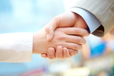 Handshake of business partners after signing contract Stock Photo - 6894925