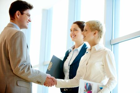 Photo of successful business partners handshaking at meeting Stock Photo - 6894947