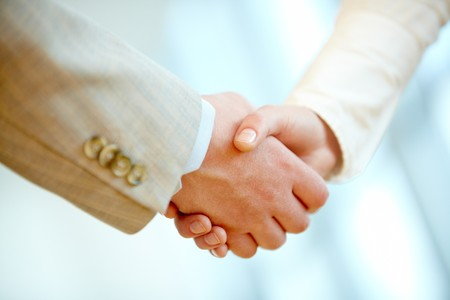 Handshake of business partners after signing contract Stock Photo - 6894927