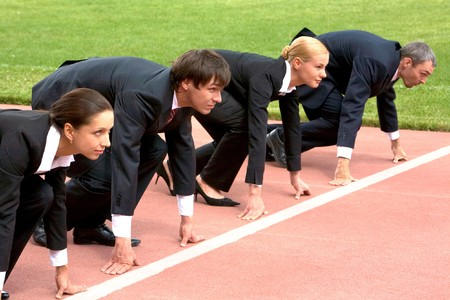 competitor: Confident business people lined up getting ready for race