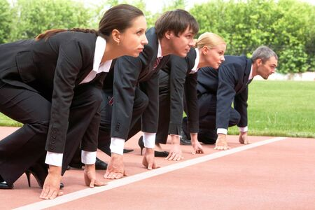 contender: Row of business people getting ready for race Stock Photo