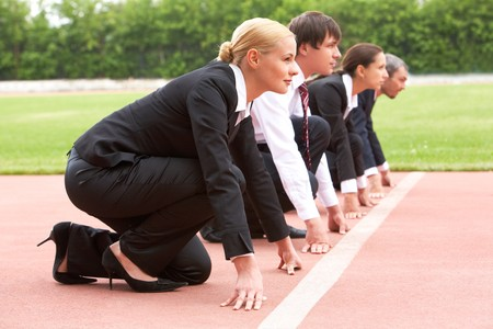 Row of business people looking attentively forwards before signal to run Stock Photo - 6895034