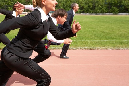 businessman running: Image of active employees running down sport track  Stock Photo