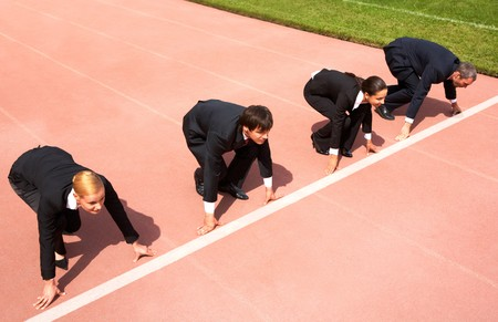 contender: Confident business people lined up getting ready for race