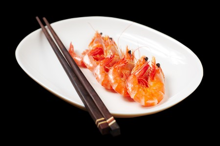 Image of tasty shrimps lying in row with two chopsticks near by Stock Photo - 6981327