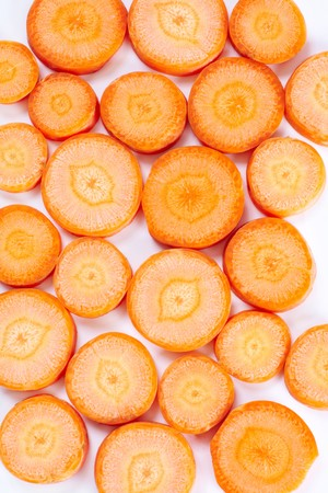 Background of round sliced raw carrots Stock Photo - 6981334