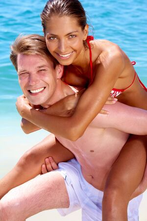 Portrait of joyful couple having fun in the water photo