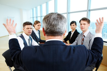 confused woman: Confused specialists looking at their senior leader with misunderstanding  Stock Photo
