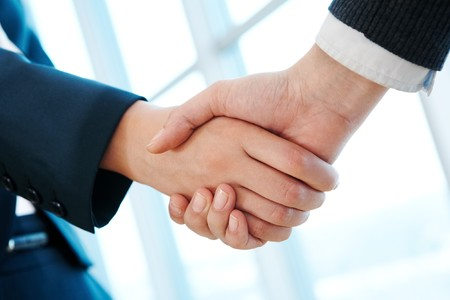 Photo of handshake of business partners after striking deal  Stock Photo - 6981335