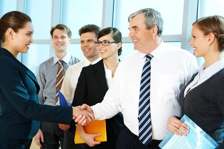 Photo of successful associates handshaking after striking deal with partners near by Stock Photo - 6963019