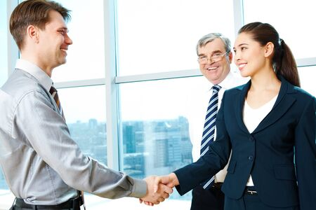 Photo of successful partners handshaking after signing agreement Stock Photo - 6962977