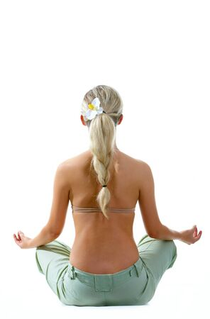 Rear view of meditating woman sitting over white background photo