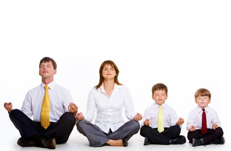 lotus pose: Photo of friendly family sitting in pose of lotus in a row and meditating over white background