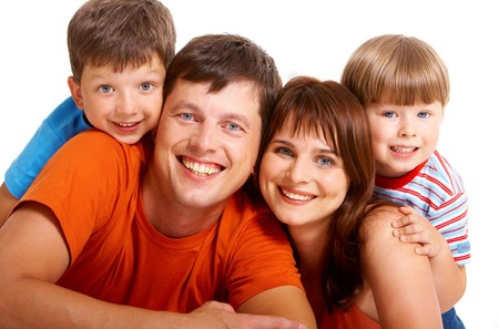 Portrait of joyful family laughing and looking at camera on white background photo