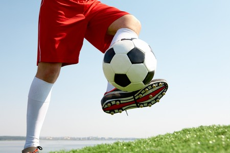 hit: Horizontal image of soccer ball being kicked by footballer Stock Photo