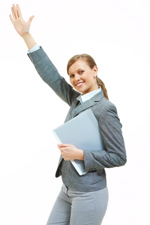 Portrait of successful female raising her arm while looking at camera photo