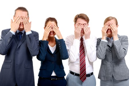 eyes closing: Row of business partners closing their eyes by hands and smiling Stock Photo