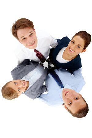 Above view of several happy business partners looking at camera while embracing each other Stock Photo - 6963307