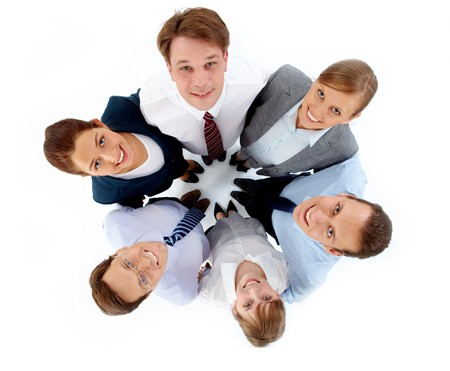 coworker: Above view of several successful associates looking at camera while embracing each other