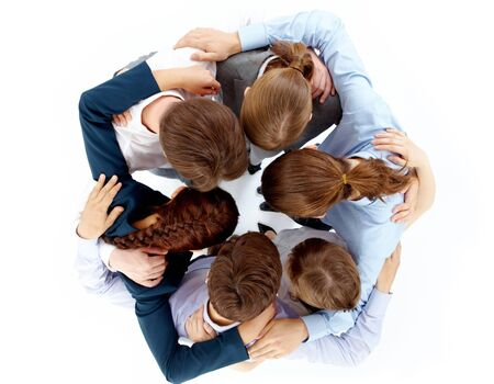 fellowship: Above view of several business partners nodding heads and embracing each other standing in circle