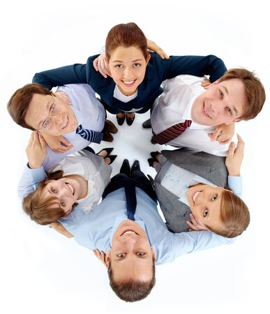 support group: Above view of circle of successful associates looking at camera with smiles