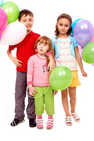 three persons: Portrait of kids with colorful balloons at birthday party