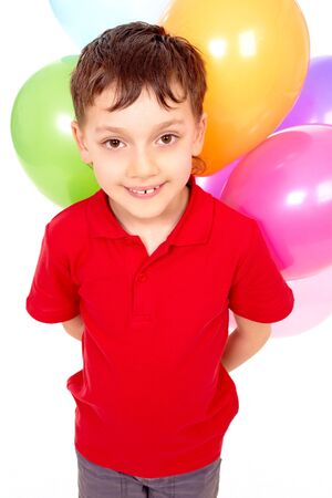 Portrait of happy boy with colorful balloons at birthday party Stock Photo - 6981397