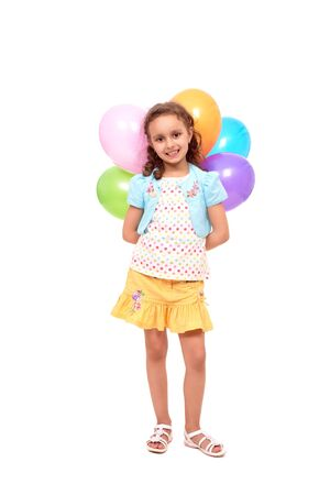 Portrait of smart girl with colorful balloons isolated on white background photo